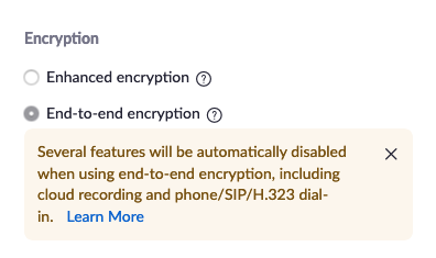 """Screenshot. The title says """"Encryption"""" There are two radio boxes. The first is labeled """"Enhanced encryption"""". The second is labeled """"End-to-end encryption"""". There is a warning box that says """"Several features will be automatically disabled when using end-to-end encryption, including cloud recording and phone/SIP/H.323 dial-in. Learn More"""""""